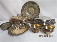 Silver entrees, cream and sugar, wine bottle rest,