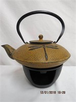Cast iron Dragonfly teapot on warming stand