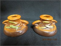 Pair of Roseville candle holders, small chip on