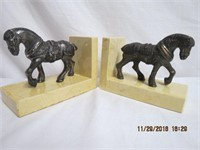 Pair of horse bookends on marble bases