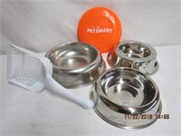 Dog bowls, litter scoop and frisbee