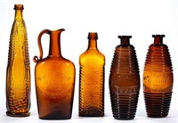 Selection of figural bottles and flasks.