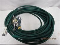 Approx 50' of garden hose with sprinkler