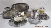Assortment of silver serving pieces and a pyrex