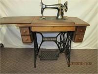 Singer walnut case treadle sewing machine