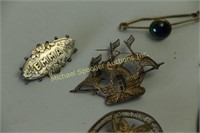7 PIECES OF COSTUME JEWELLERY, ONE STERLING