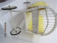Wicker bassinet on wire and rubber wheels