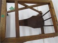 Antique child's walker on casters