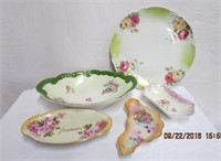 4 floral decorated bowls and a large serving plate