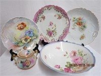 Collection of floral decorated plates, bowl, sugar