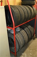Tire Rack with  Assorted Tires - some on rims