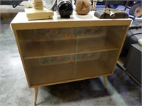 blond glass front bookcase