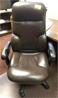 Rolling leather office chair and plastic mat