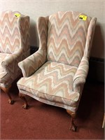 High back, upholstered chair