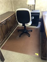 Rolling office chair with plastic mat