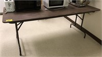 6' foldable banquet table, contents not included