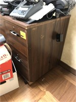 Rolling, wooden file cabinet, contents on top not