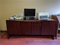 Wooden office desk and credenza contents on top