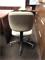 Upholstered, rolling office chair