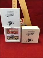 Two sets department 56 Cars