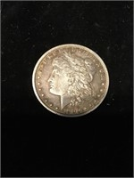 1900 Morgan silver dollar O