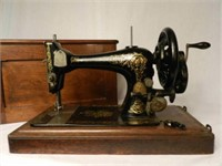 Singer sewing machine with original wood cover