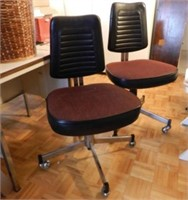 Pair of vintage office chairs, ribbed black leather back