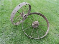 Pair of antique iron wheels, perfect for garden decor