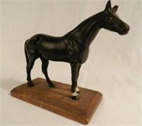 Cast iron horse on wood base