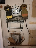 Shelf With Contents and Decorative Items On Wall