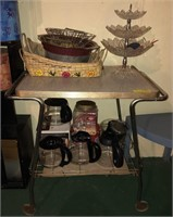 Cart With Coffee Pots, Wicker Baskets, and More
