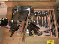 Cabinet With Counter Top and Kitchen Utensils