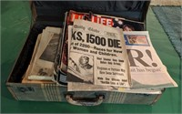Vintage suitcase full of historic newspapers.