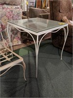 Metal table with glass top
