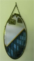 Antique hanging oval mirror with beveled glass