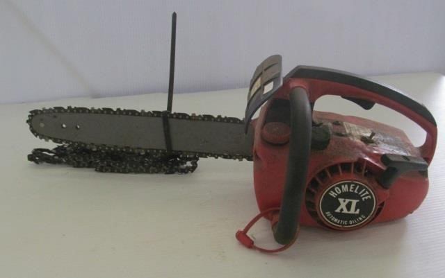 Homelite Textron XL chainsaw with extra chains    Rowley