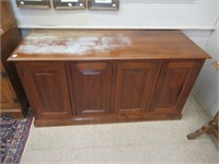 Walnut lift top cabinet water damage on