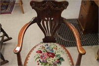 Early needlepoint arm chair