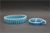 2 blue glass dishes