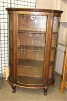 Oak triple bow glass China cabinet