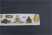 Group of millitary badges