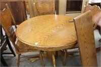 Oak pedestal table with leaf & 4 pressed back