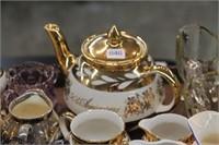 Tray of cream & sugars & teapot