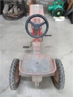 International pedal tractor (bad tire)
