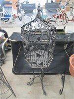 Metal caged plant stand