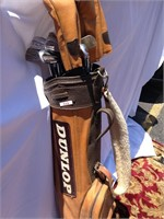 Dunlop leather golf bag & assorted clubs