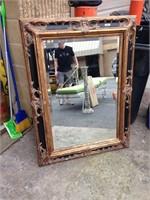 Large ornate mirror hand craved fram