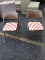 Pair of metal folding chairs with cushions