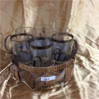 Drinking glasses in a basket holder