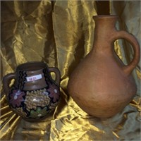 Assorted pair of clay gourd pitchers